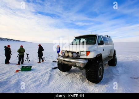 Tourists visiting Crystal ice cave in Breidamerkurjokull glacier,Iceland - Stock Photo