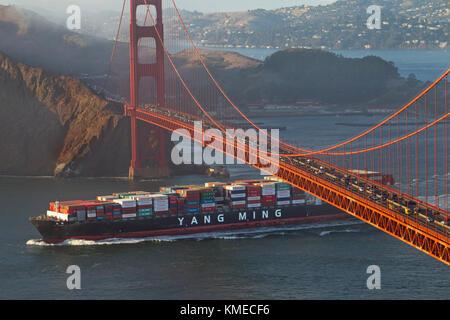 Freighter sailing under Golden Gate Bridge in San Francisco Bay, San Francisco, California, USA - Stock Photo
