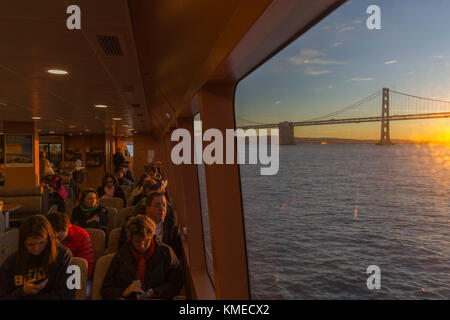 Passengers in commuter ferry from Tiberon to San Francisco Ferry Building,California,USA - Stock Photo