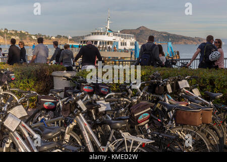 bicycles,people and ferry in background,Sausalito,California,USA - Stock Photo