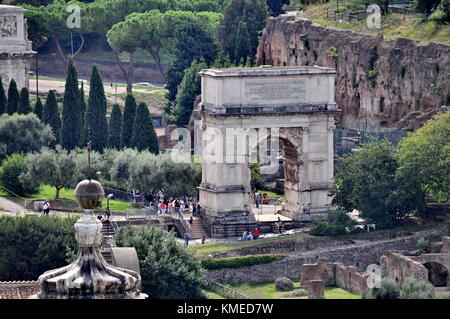 Rome, Italy - September 9, 2015: Tourists visit the Arch of Titus located in the Roman Forum in Rome, Italy. - Stock Photo
