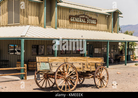 Old wagon standing in front of Death Valley National Park general store,California,USA - Stock Photo