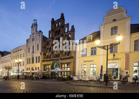 Pavement Cafes in front of old warehouse Alter Schwede, Wismar, Germany - Stock Photo