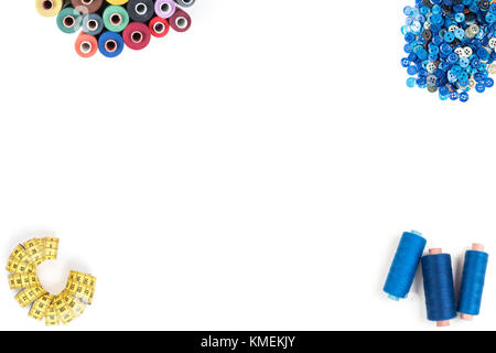 Sewing supplies thread, buttons, tape, scissors on white background. Text, cover, print, poster ready - Stock Photo