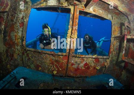 Divers peer through windows on bridge of USS Kittiwake