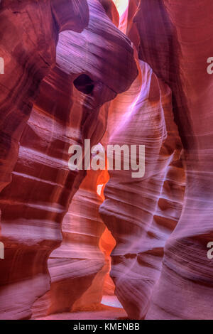 Looking back toward the entrance of Upper Antelope Canyon lit with dim bounce light in Page, Arizona. - Stock Photo
