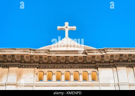 Cross on the Church of Santa Maria Assunta in Positano town in autumn, Amalfi coast, Italy - Stock Photo
