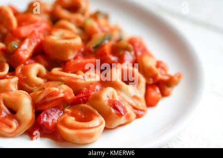 Tortellini Primavera Parmesan In Marinara Sauce On Wooden Rustic Background - Stock Photo