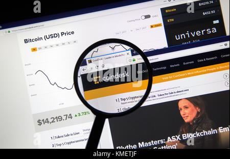 MONTREAL, CANADA - DECEMBER 7, 2017: Coindesk home webpage and logo under magnifying glass. CoinDesk is a news site - Stock Photo