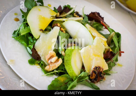 Salad With Pears, Walnuts And Cheese On White Plates - Stock Photo