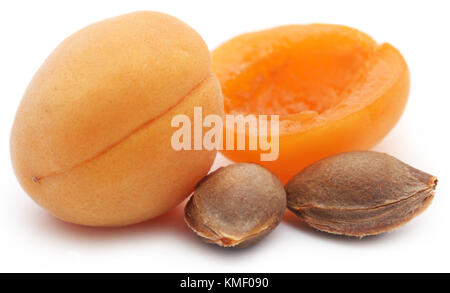 Fresh apricots with seed over white background - Stock Photo