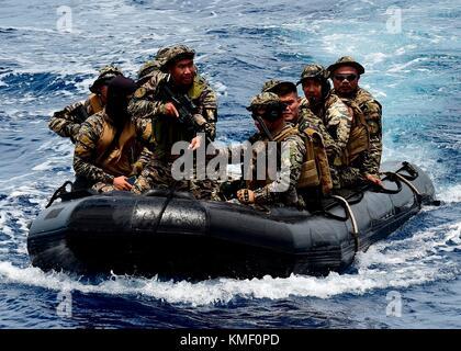 Philippine Navy sailors approach the U.S. Navy Spearhead-class expeditionary fast transport ship USNS Millinocket - Stock Photo