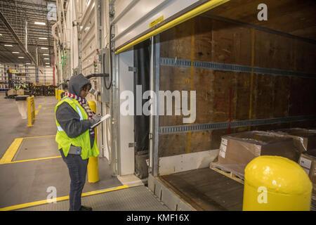 Romulus, Michigan - A dispatcher checks the contents of trailers at a Mopar auto parts distribution center. Mopar - Stock Photo