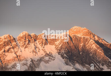 Sunset over Mount Everest viewed from Tengboche, Nepal - Stock Photo