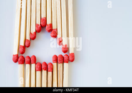 CHRISTMAS TREE SHAPE MADE UP OF MATCHES - Stock Photo