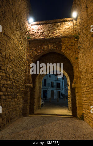 Ancient gateway in city walls, Puerta de Almocabar, Horseshoe arch, Ronda, Andalusia, Spain. - Stock Photo