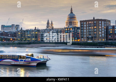 St Paul's Cathedral and City of London, river Thames,  London England UK - Stock Photo