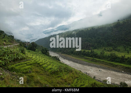 Trekking along the wild Budhi Gandaki River on the Manaslu Circuit Trek, Nepal - Stock Photo