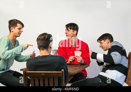 young man playing poker against himself - Stock Photo