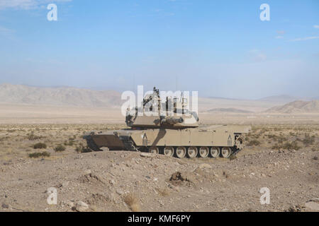 U.S. Army Soldiers assigned to 1st Brigade Combat Team 1st Cavalry Division 2-5 Cavalry Battalion scan the area - Stock Photo