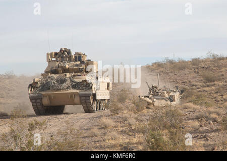 U.S. Army Soldiers assigned to 1st Brigade Combat Team 1st Cavalry Division 2-5 Cavalry Battalion move to contact - Stock Photo