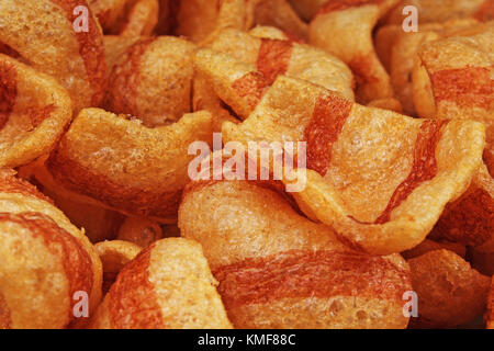 Bacon flavored snacks. Bacon chips flips background pattern texture. - Stock Photo