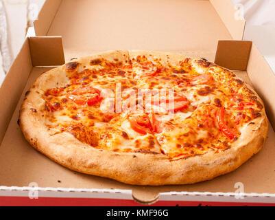 Italian Pizza Margherita Margarita with tomato and Mozzarella cheese background. Pizza delivery banner ad wallpaper. - Stock Photo