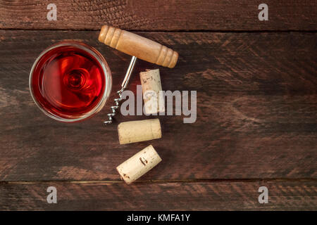 Wine corks, glass, and corkscrew with copy space - Stock Photo