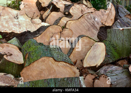 a large pile of cut or sawn, chopped fire wood or logs ready in a pile for burning on an open fire or stove. A stack - Stock Photo