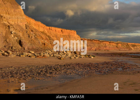 a beautiful and atmospheric landscape or seascape image of the cliffs ant Compton bay on the isle of wight in warm - Stock Photo
