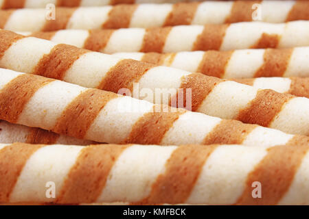 Ice cream wafer sticks as background. Wafer biscuit swirled stick texture. Wafers pattern. - Stock Photo