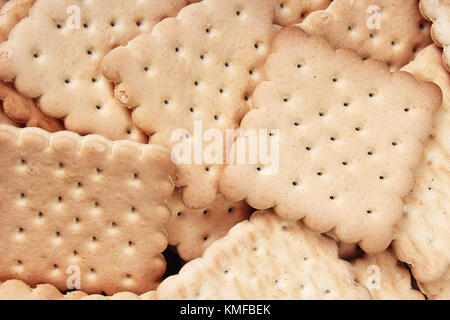 Biscuit sweet cookie craker background. Domestic stacked butter biscuit pattern concept. Biscuits texture close - Stock Photo
