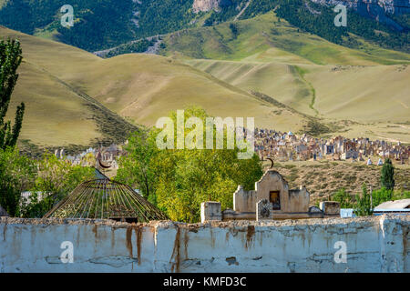 Tombstones in old muslim cemetery, Naryn, Kyrgyzstan - Stock Photo