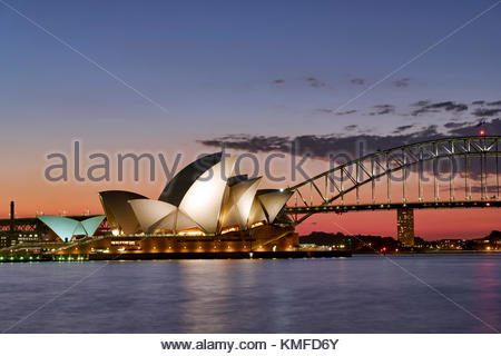 The Sydney Opera House and Harbour bridge at sunset. Sydney, Australia - Stock Photo