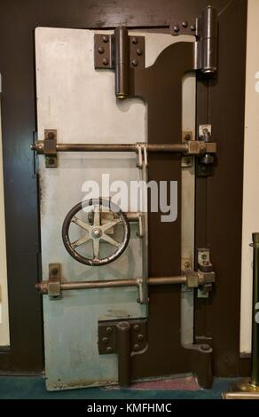 An old bank vault door at the Halifax Historical Museum in Daytona Beach, Florida, USA. - Stock Photo