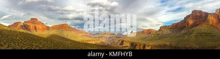 Wide Panoramic Landscape and Dramatic Cloudy Sky over Arizona Grand Canyon National Park from Great Hiking Trail - Stock Photo