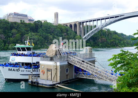 Visitors (tourists) boarding the Maid of the Mist ferry boat at Niagara Falls, New York, USA - Stock Photo