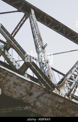 Rusty railway bridge. - Stock Photo