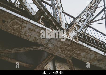 Rusty railway bridge from the bottom. - Stock Photo