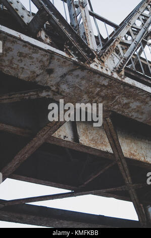Vertical composition. Railway bridge from the bottom. - Stock Photo
