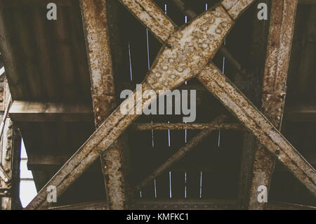 Rusty bridge from the bottom. - Stock Photo