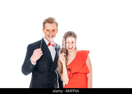 couple with heart shaped glasses on sticks - Stock Photo