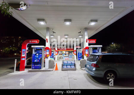 Toronto, Canada - Oct 19, 2017: Fuel pumps at an Esso gas station at night - Stock Photo