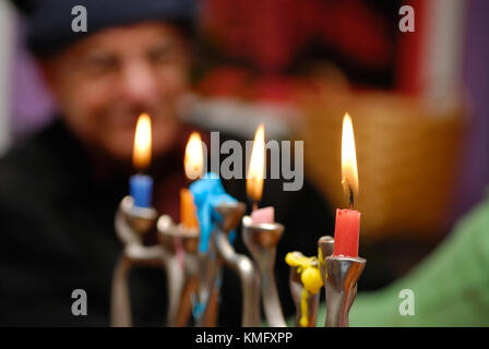 Hanukkah menorah background. Closeup of candles burning during the celebration of Hanukkah, a Jewish holiday, old - Stock Photo