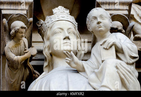Paris, France. Notre Dame cathedral / Notre-Dame de Paris on Isle de la Cite. Gothic. Facade detail. Madonna and - Stock Photo