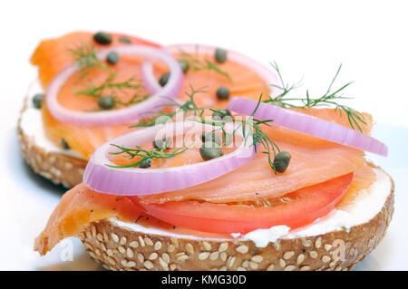 Smoked salmon and sesame seed bagel isolated on white - Stock Photo