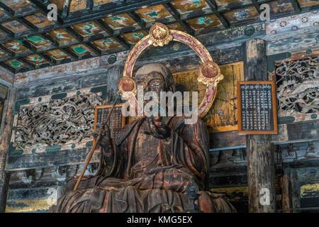 Kencho-ji temple Butsuden Hall Jizo Bosatsu statue. Ceiling ornaments of the Momoyama period style. Japan Important - Stock Photo