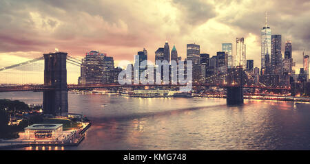 Scenic sunset over New York City, color toned picture, USA. - Stock Photo