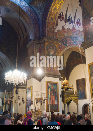 Sunday mass in the imposing cathedral at Mother See of Holy Etchmiadzin, seat of the Apostolic Church, in Vagharshapat - Stock Photo