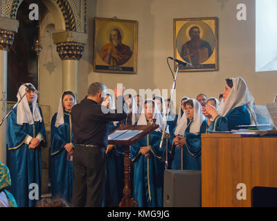 Sunday mass in the imposing cathedral at Mother See of Holy Etchmiadzin, seat of the Apostolic Church, in Vagharshapat, - Stock Photo